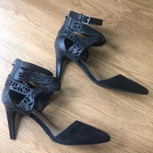 Black heels with detailed cut out leather.